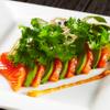 ガンボ&オイスターバー - 料理写真:サーモンとアボカドのカルパッチョ ドライトマトソース