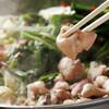 元祖 もつ鍋 楽天地 - 料理写真:出来上がり、、秘伝のスープと新鮮なモツとキャベツとニラ、、究極の美人鍋。もつ鍋美人が大集合!