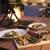 ブランチキッチン - 内観写真:MERCERブランドの象徴の暖炉。夜は柔らかい火の光が店内を照らします。