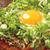 鶴橋風月 - 料理写真:「牛すじねぎ月見玉」仕上げにねぎと目玉焼きをのせてさらに美味しさUP!