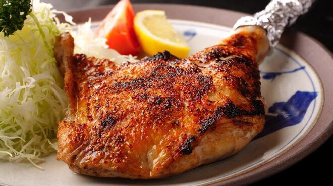 鳥源 - 料理写真:よつわり 骨付もも焼き1本。王道です。
