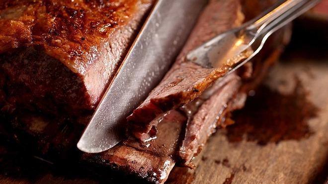 バルバッコア - 料理写真:スペアリブ!骨付きカルビです。脂身が多く柔らかくて美味です☆