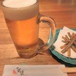 10646383 - 骨せんべいとビール