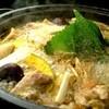 川田流 新大阪 - 料理写真:【地鶏鍋】たっぷりのコラーゲンが溶け出したスープは、丸鶏を半日かけ、じっくり煮込んで作った絶品。