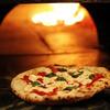 バジリコ - 料理写真:薪で焼くピッツァ用の本格窯