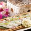 ひだまり 花 - 料理写真:活タコのネギ塩七厘焼き(ディナーメニュー)