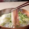 立川うまやの楽屋 - 料理写真:「黒豚ばら肉しゃぶしゃぶ鍋」。レタスなどたっぷりの野菜と一緒に、2種類のとんこつスープで。