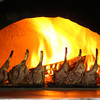 ルチアーノ - 料理写真:薪窯仕立てのお肉