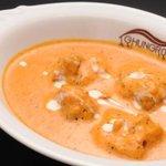 ゴングル - 人気メニュー、バターチキン。 さっぱりした辛さとさわやかな酸味、ほのかな甘みが絶品です。