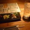 若武者 - 料理写真:芋焼酎黒霧島水割り、付きだし(厚揚げ、マカロニサラダ、カイワレと鯖)