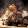 長崎卓袱浜勝 - 料理写真:【甘鯛の石焼】 対馬の根緒石を使用した、浜勝自慢の一品。中までふっくら焼き上がった魚介の味わいは格別。