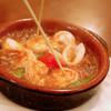 川口バル - 料理写真:【ある日のおすすめ】プリプリ海老イカアヒージョ。ガーリックの風味がたまらない一品。熱いうちにどうぞ!