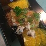 西村食堂 - 前菜的なオレンジソースのカルパッチョ。