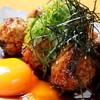 焼き鳥ダイニングバーみつを - 料理写真:人気の月見つくねはとろとろの地鶏卵をからめてお召し上がりください♪