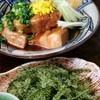 うるうるま - 料理写真:らふてぃ/海ぶどう 泡盛と黒糖で時間をかけてじっくり煮込んだらふてぃと、久高島産の茎付き海ぶどう。