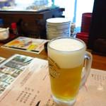 石田屋 - キリン一番搾り樽詰め生ビール(中ジョッキ)500円