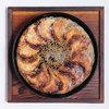 GYOZA BAR 杏っ子 - 料理写真:当店一番人気の鉄鍋ぎょうざ 980円(12個)、700円(8個)