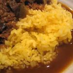21646474 - 日本米のサフランライスは、シャバ系カレーに合うようにやや固めの炊きあがり。
