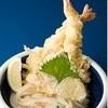 おか泉 - 料理写真:ひや天おろし:出来たて麺の上に、巨大エビ天2本がそびえ立つ当店の看板メニュー。熱々の天ぷらと、絹のようにしなやかな麺。この2つの組み合わせが至福の時へ誘います。