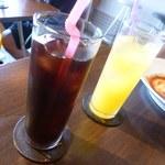 Manly - プラス100円のセットのドリンクはアイスコーヒーとマンゴーのジュース