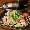 HONA - 料理写真:オリジナルレシピ『HONAトマトお好み焼き』。ワインが合います!