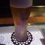 里味 - 生ビールはサッポロ(500円)。