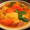楽仙樓 - 料理写真:卵とトマト炒め980円   中国北方家庭の代表料理。