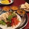 サクティ - 料理写真:手前にサラダ、奥にカレー、別皿にナンとサフランライス