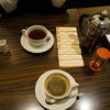 Cafe Morozoff - ドリンク写真:コーヒーと今回は使うぞと出してある、クーポン。