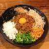 つけ麺本丸 - 料理写真:ピリッと旨辛いミンチは特製の太麺とよく合いクセになる味。具もたっぷりでボリューム満点。