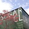 シュガー クラブ - 外観写真:国道沿いのグリーンの倉庫風外観が目印のSUGARCLUB