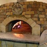 檪の丘 - くぬぎの薪を使ってピッツアや肉などを焼く石窯です
