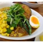 27038228 - ジャガイモ・人参・コーン・オクラ・玉ねぎ・茹で卵等が入っています。                        人参以外はスープカレーのお野菜としては小ぶりの印象。
