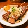 立呑みもつ焼処 柏二丁目酒場 - 料理写真:ネギレバ(1串180円)