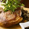 俺のイタリアン - 料理写真:米沢豚の骨付き豪快ロースト 焦がしにんにくポートワインソース ¥1,280