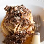 シンポジウム - 料理写真:ポルチーニの入ったお肉のラグー