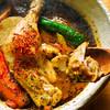 薬膳スープカレー・シャナイア - 料理写真:熟成チキンと野菜のスープカレー。柔らかく煮込んだ骨付きチキンがまるまる一本入っています。 食べごたえ十分。