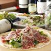 AJITO - 料理写真:生ハムとルッコラのピザ
