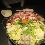 35409255 - 豚バラの入った鍋。白菜柔らかく、だし汁も美味しかった。最後に中華麺入れましたが、これまた絶品でした。
