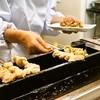 山根商店 - 料理写真:女将さんが串を焼いてくれます