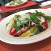 トラットリアカプリオーレ - 料理写真:ホリデーランチのタコのサラダ、野菜の素材が良くない。量を少量にしてでも、もっといい食材を使って欲しい(雰囲気が素敵なので期待してしまうんです)盛り付けも雑だし、切り方も雑、ファミレスクラスです。
