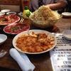 炭火焼肉 西遊記 - 料理写真:手前ホルモン、奥は西遊記サラダやカルビ