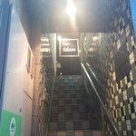 サルーン - 階段を見上げるとライトアップされた看板が目印です。