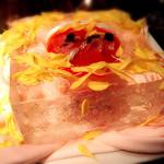 39788678 - トマトとお魚のスープ。氷で出来た入れ物にお花は食べれるお花。