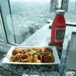 39889370 - 高階層からの景色を見ながら食べるたこ焼きも乙なもの。