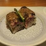 41119467 - 秋刀魚棒寿司。