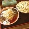 くをん - 料理写真:福島駅近辺で評価の高いくをんさんで、辛野菜つけ麺中盛をいただきました。この麺はもううどんと、言ってもいい太さ。けど、意外とツルツル行けます。昨晩の食べ過ぎがたたりなかなか後半苦しい闘いになりましたが完食。ご馳走様でした。