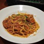 オステリア パージナ - 豚バラ肉と玉葱のトマトソース