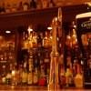 Dining Bar RR - ドリンク写真:バーカウンター奥の棚に並ぶお酒。