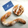 グルグルベーカリー - 料理写真:シナモンのグルグルと幸せのかぎしっぽパン